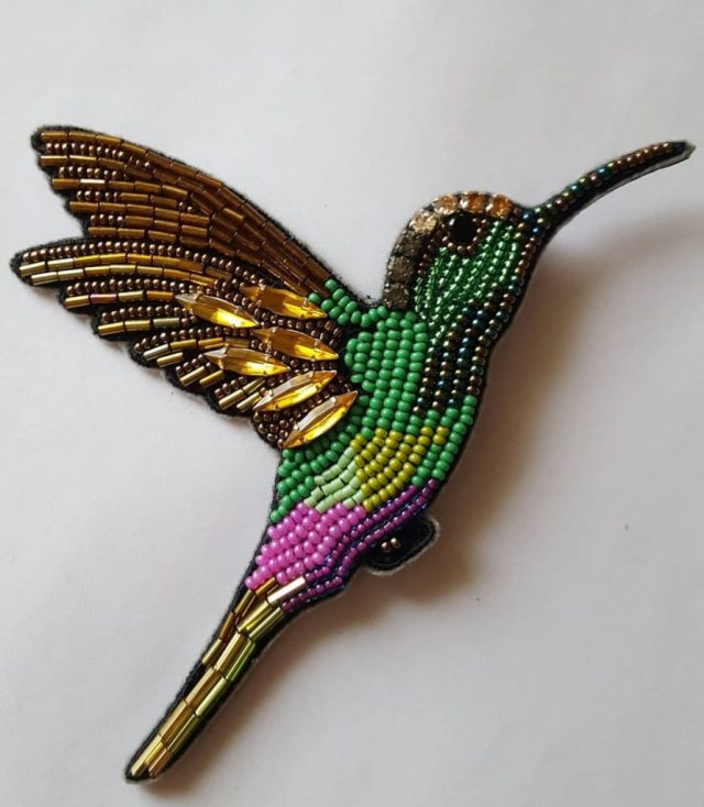 Птичка колибри-необычайно яркая и красивая